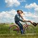 couple-romancing-on-pink-bike