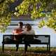 Couple sitting on the park bench