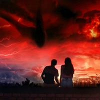 Couple watching dramatic clouds and storm system