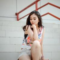 Cute Asian Girl posing on the steps