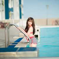 cute-asian-girl-stepping-out-of-the-pool