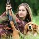 Cute Female Hunter with Rifle Gun and Dog