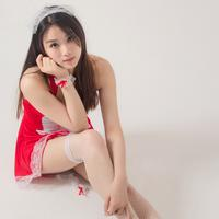 Cute Young Female Model wearing red dress and stockings