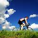 cyclist-riding-under-blue-skies