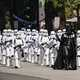 Darth Vader and storm troopers marching in parade
