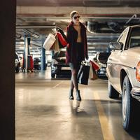 Fashionable Woman Walking towards Car