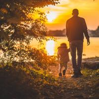 Father and Child walking at sunset