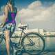female-cyclist-looking-across-the-bay