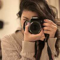 female-photographer-taking-photo
