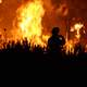 firefighter-taking-a-photograph-of-the-fire-blaze