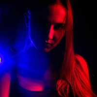 girl-dark-room-in-blue-and-red