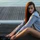 girl-in-gray-hoodie-sitting-on-the-dock