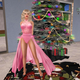 Girl in Pink Dress Next to Christmas Tree