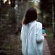 girl-in-white-shirt-walking-in-the-woods