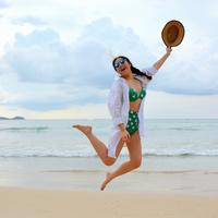 Girl Jumping for joy on the beach