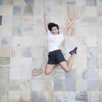 Girl jumping next to wall