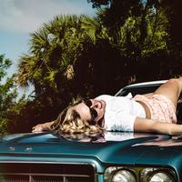 Girl lying on car