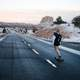 girl-skateboarding-down-the-road