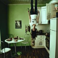 Girl standing upside down from the roof