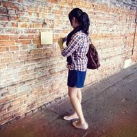 Girl taking cellphone picture of wall
