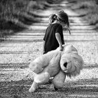 Girl walking giant teddy bear