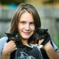 Girl with 2 cute cats