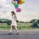 Girl with white dress and Balloons