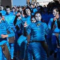 Group of people in blue face paint and costumes