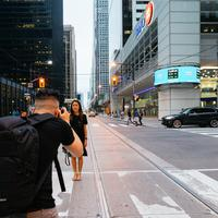 Guy taking picture of girl on the street