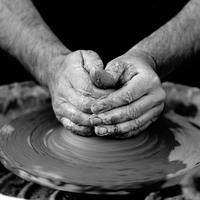 Hands working clay making Pottery