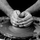 hands-working-clay-making-pottery