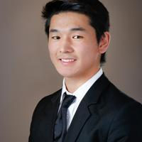 Handsome young asian man in a suit