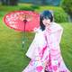 Japanese Girl wearing pink Kimono with red umbrella