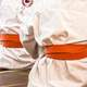 karate-orange-belts-in-a-dojo