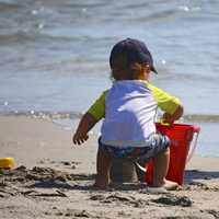 kid-on-the-beach-building-sand-castle