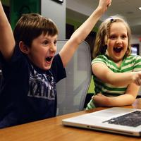Kids excited at a laptop