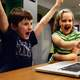 kids-excited-at-a-laptop