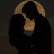 man-and-woman-silhouette-kissing-in-the-moon