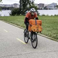 man-carrying-packages-on-a-bike-on-a-bike-path