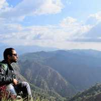 man-in-high-mountains-looking-at-sky