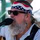 man-singing-with-patriotic-headband-free-stock-photo
