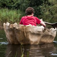Man sitting in a rowboat rowing away