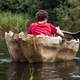 man-sitting-in-a-rowboat-rowing-away