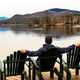man-sitting-in-the-chair-looking-at-lake-scenery