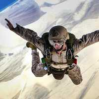 man-skydiving-with-a-parachute