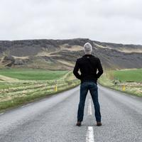 Man standing in the middle of the road in Iceland