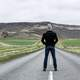 man-standing-in-the-middle-of-the-road-in-iceland