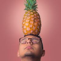 Man with pineapple on head
