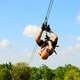man-zip-lining-upside-down