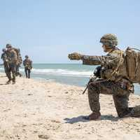 170719-M-QX735-018 MYKOLAYIVKA, Ukraine (July 19, 2017) - A U.S. Marine with 3rd Battalion, 23rd Marine Regiment, orders his squad into position during a beach assault July 19, in Mykolayivka, Ukraine, during exercise Sea Breeze 2017.  Sea Breeze is a U.S. and Ukraine co-hosted multinational maritime exercise held in the Black Sea and is designed to enhance interoperability of participating nations and strengthen maritime security within the region.  (U.S. Marine Corps photo by Staff Sgt. Marcin Platek/Released)
